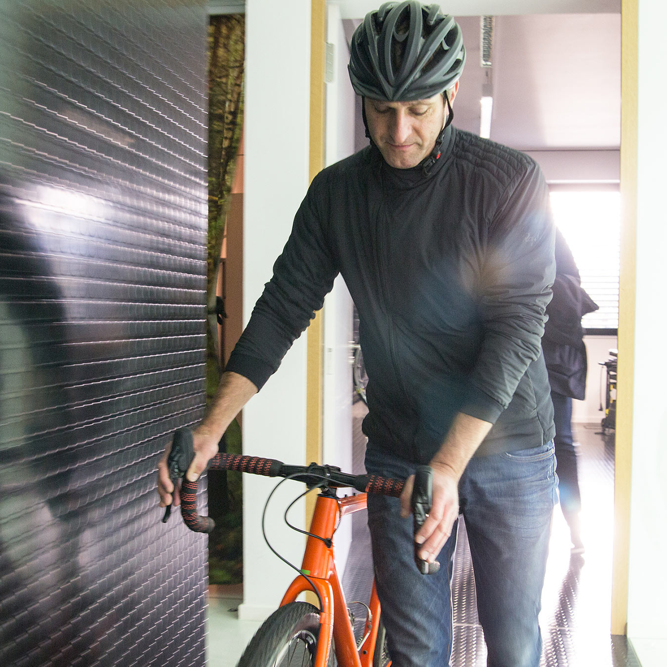 A bike is pushed through the corridors at Ergon headquarters.