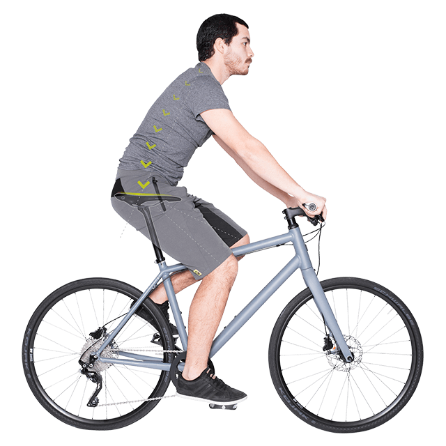 A man is sitting on a bike. Arrows showing where the pressure is applied to the saddle.