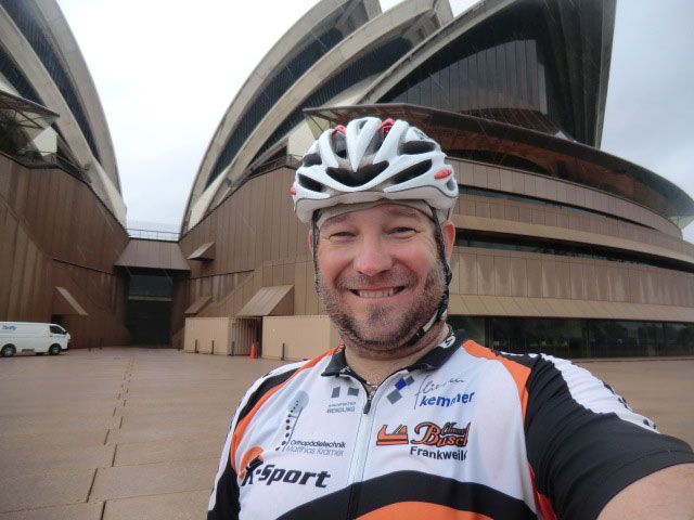 A selfie of Frank in front of the Sydney Opera House.